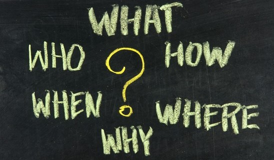 what, when, where, why, how, who questions - white chalk handwriting on  blackboards